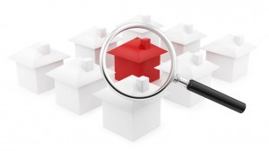 Red house with magnifying glass